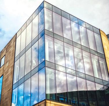Полуструктурное остекление фасадов
